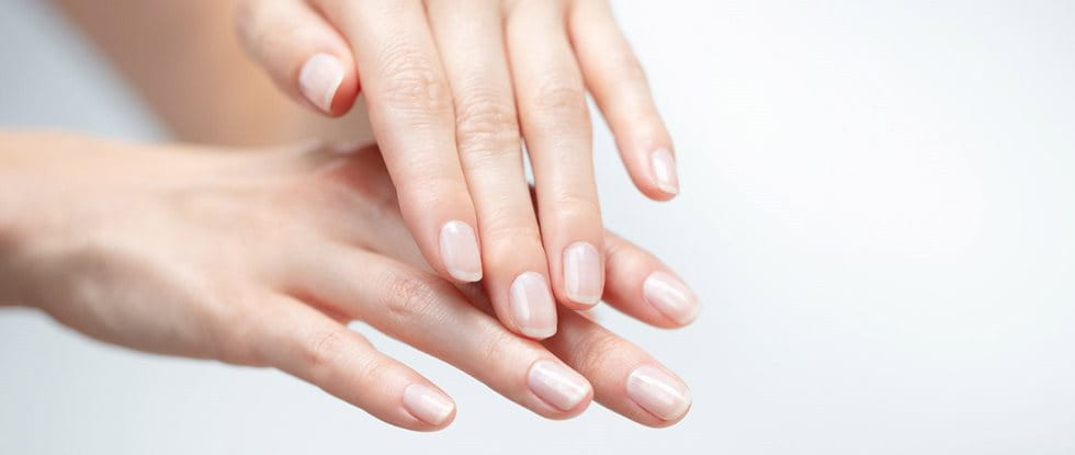 Cracked skin is common on fingers, hands and feet